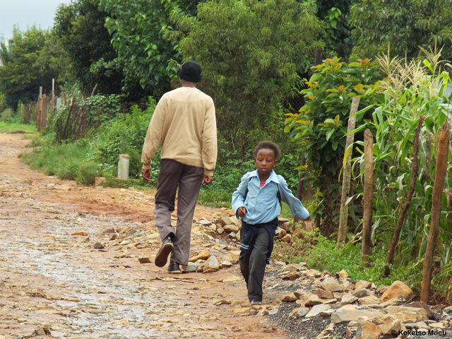 A young learner on her way home from school.