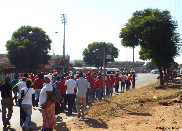 Supporters heading for the stadium from their bus in Maunde Street, Atteridgeville.